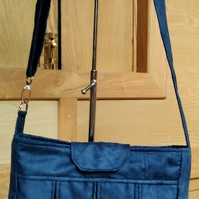 Navy faux suede box pleat bag