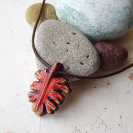 Red leaf pendant, hand carved and painted on wood