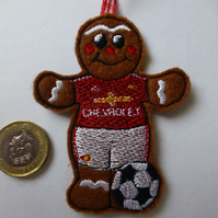 Christmas tree decoration - gingerbread man footballer in Manchester Utd colours