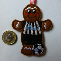 Christmas tree hanging decoration gingerbread footballer in Newcastle colours