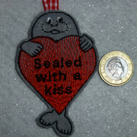 Hanging valentines decoration sealed with a kiss - seal hugging heart
