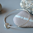Silver bangle with donut charm, 925 sterling silver, hammered, 2mm wide band, re