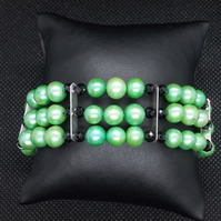 Apple green pearl three strand bracelet