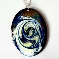 enamel pendant - oval scrolled white and gold, ondark blue over clear