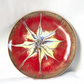 enamelled dish: scrolled white, gold and blue on red over clear