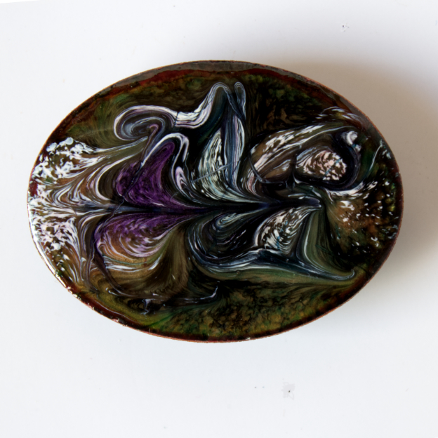 enamelled brooch: white, and amethyst on black over clear enamel