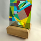 Abstract Glass Screen and Wooden Candle Holder