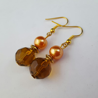 Brown and orange dangly earrings