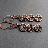 Spiral earrings in antique copper