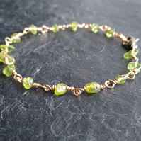 Peridot and champagne gold colour wire wrapped bracelet