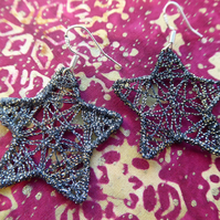 Black and gold star earrings