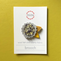 Grey and yellow felt brooch with Liberty fabric centre