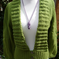 Ladies Hand knitted Green cable twist cardigan with deep ribbed bottom