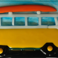 VW Camper with surfboard