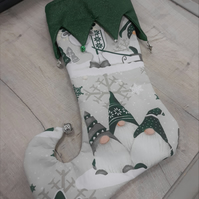 Christmas Elf stocking with green gnomes, bells and charms. (Ref CSBG1)