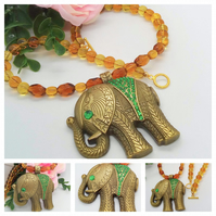 Bronze Elephant Pendant with Green Rhinestones on a Topaz Coloured Necklace