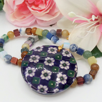 Purple Floral Pattern Mother of Pearl Shell Pendant on a Mixed Gemstone Necklace
