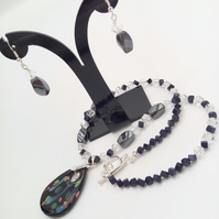 Black Teardrop Glass Pendant on a Haematite and Crystal Necklace & Earrings