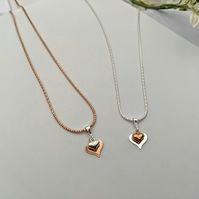 Double heart pendant available in rose gold or silver