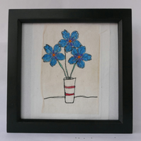 Blue Flowers in a Striped Vase