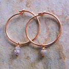 Small Pink Rough Cut Diamonds on 14K Rose Gold Hoop Earrings.