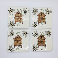 Made to Order. Set of Four Handmade Ceramic Coasters with Bumble Bees .
