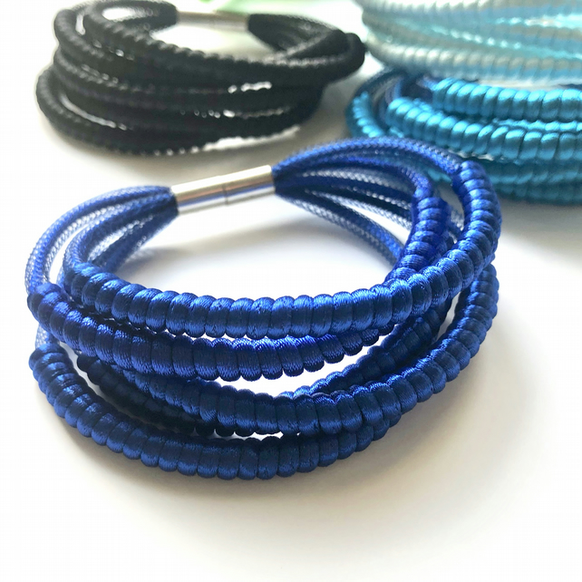 Blue cord five row textile bangle.