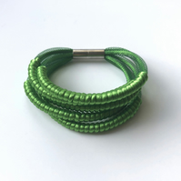 Bright green cord wrapped five row bangle.