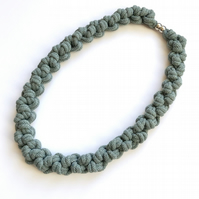 Teal hand knotted cotton rope necklace.