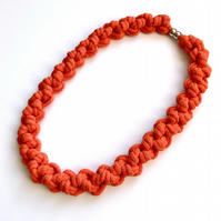 Chunky knotted orange cotton necklace.