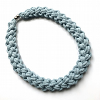 Pale blue hand knotted cotton rope necklace.