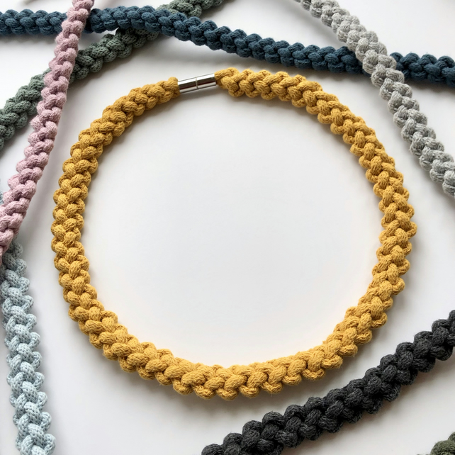 Yellow ochre hand knotted narrow cotton rope necklace.