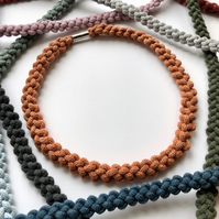Terra cotta hand knotted narrow cotton rope necklace.