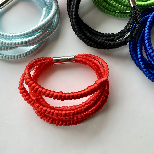 Bright red five row cord bangle.