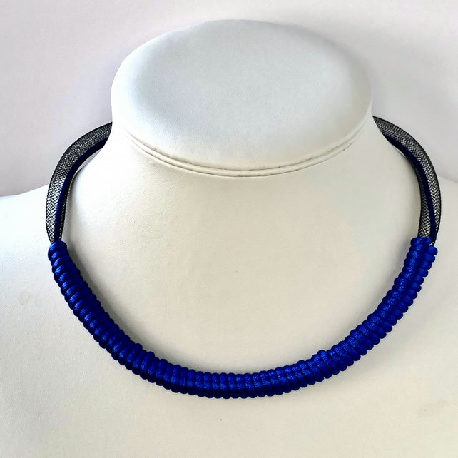 Contemporary royal blue cord and black mesh tube necklace.