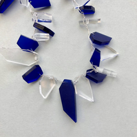 Long royal blue and transparent acrylic bead necklace.