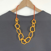 Golden yellow geometric acrylic contemporary necklace.