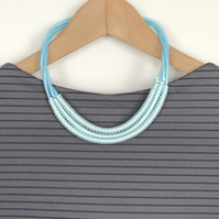 Contemporary three strand pale blue wrapped necklace.
