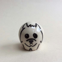 Little handmade pottery west highland terrier dog.