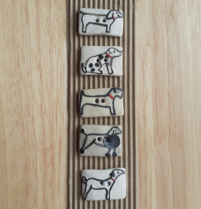 Set of 5 cream assorted dog buttons