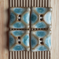 Set of 4 blue ceramic square shaped buttons