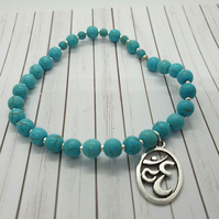 stretchy bracelet  immitation turquoise (dyed howlite ) with ohm charm