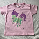 GREEN & PURPLE HORSE ON A PINK SHORT SLEEVES TSHIRT
