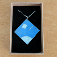Enamelled blue and white abstract cloisonné  onto copper with solid silver chain