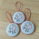 Set of three embroidered fat robin tree decorations