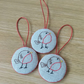 Set  of three embroidered plump robin tree decorations