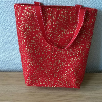 Christmas Gift or Goodies bag in red with a gold berry print