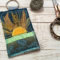 Up cycled embroidered sun keyring or bag charm.