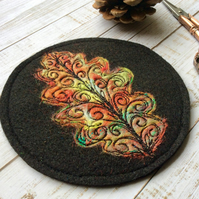 Oak leaf embroidered felt coaster.