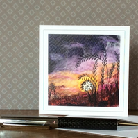Embroidered sunset landscape card.
